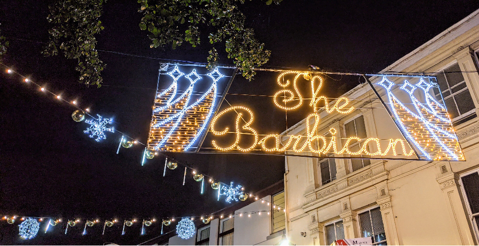 Christmas lights on Southside Street in Plymouth, spelling out The Barbican