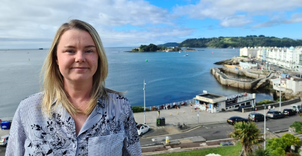 New Chief Executive of Plymouth Waterfront Partnership, Diane Mansell, stood on Plymouth Hoe with Plymouth Sound in the background
