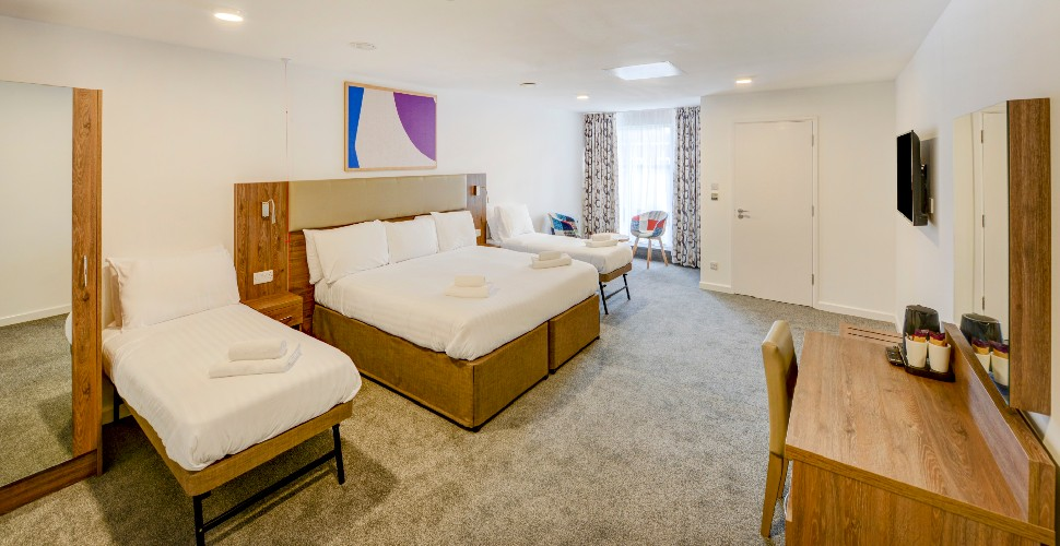 Quad room at Oyo Plymouth central, with double bed and two single beds