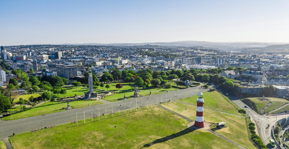 Aerial view of Plymouth looking over city, with Smeaton's Tower in the foreground