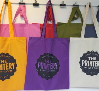 Totebags with 'The Printery' handprinted on it