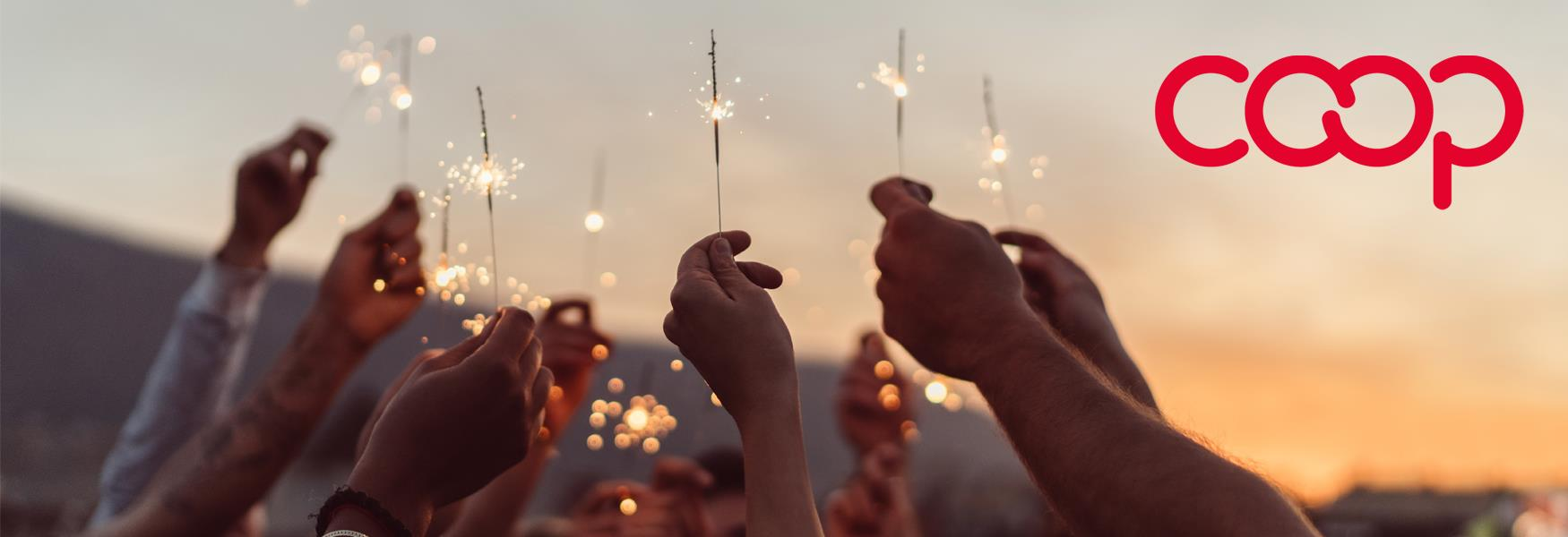 People holding up sparklers for Co-op