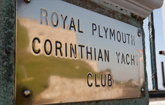 The name plaque outside the entrance to the Royal Plymouth Corinthian Yacht Club