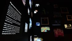 The Box's media lab gallery with digital screens showing text about Plymouth and images